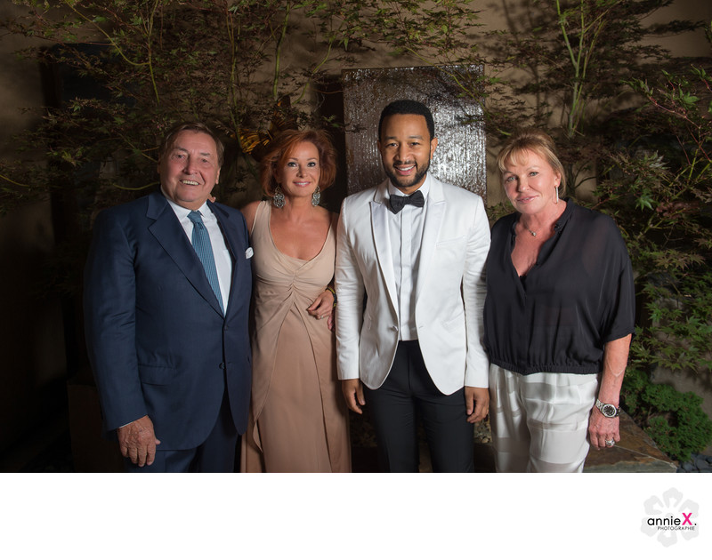 party host with John Legend