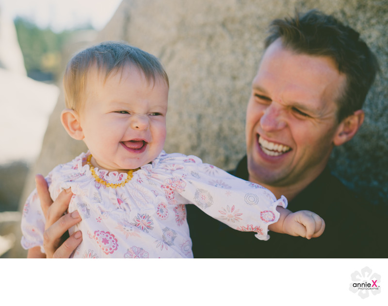 Father and baby girl laughing in Lake Tahoe