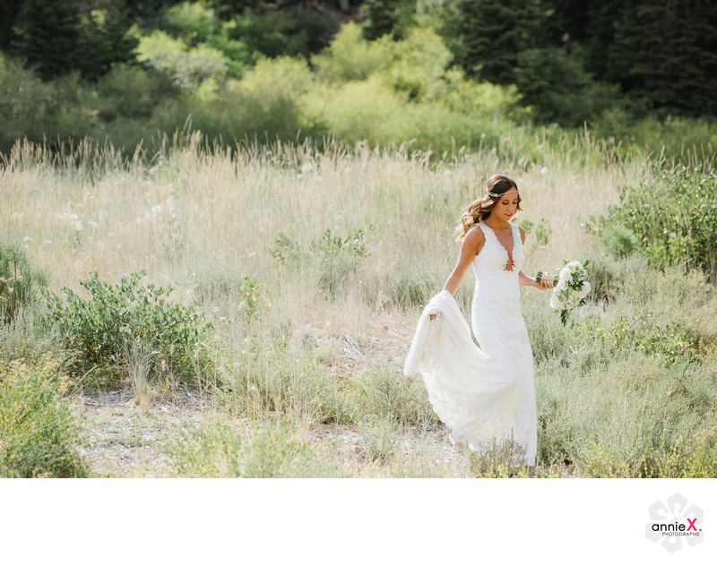 Bride walking in field at Ritz Carlton