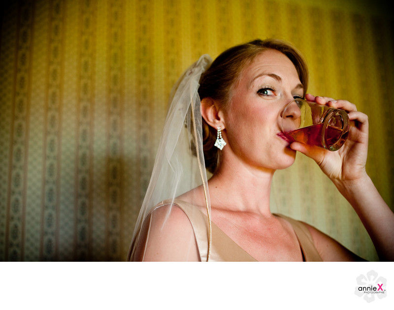 Bride drinking whiskey at gatekeepers museum in Tahoe