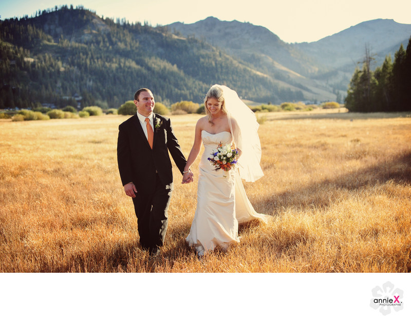 newlyweds stroll in Squaw Valley meadow in fall