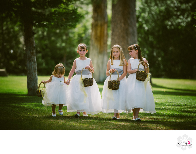 flower girls walking on lawn to ceremony