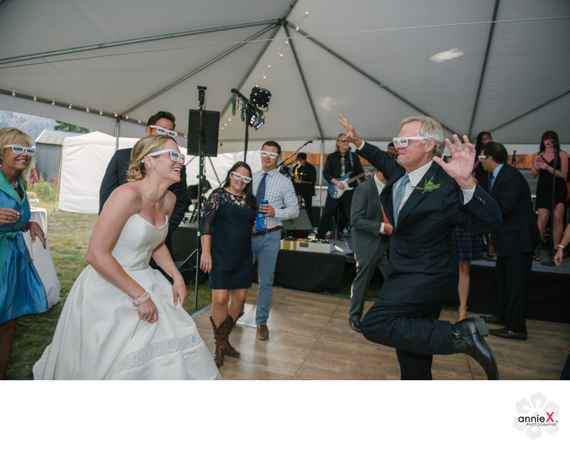 Fun bride and groom dance