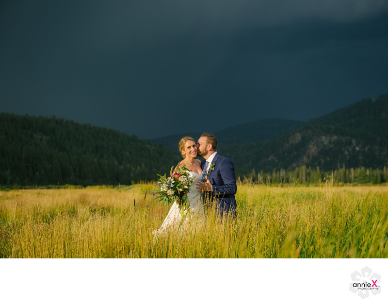 Dark storm skies with bride and groom