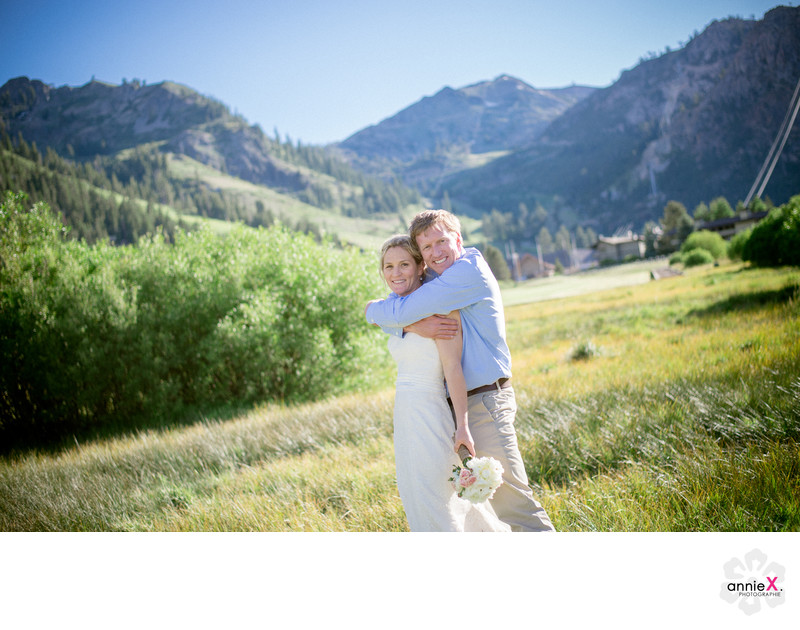 Mountain weddings photographer image in meadow