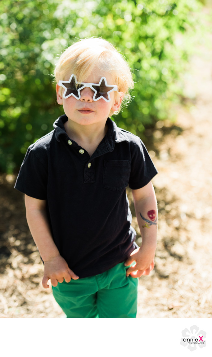 Blond boy with star sunglasses