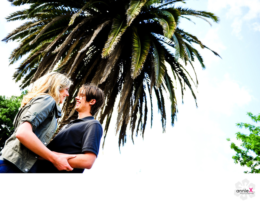 engage couple with palm tree