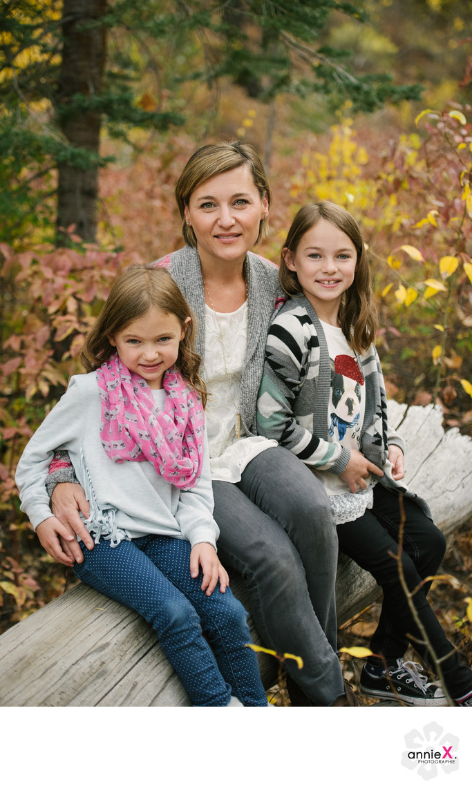 Mother and daughters with fall foliage