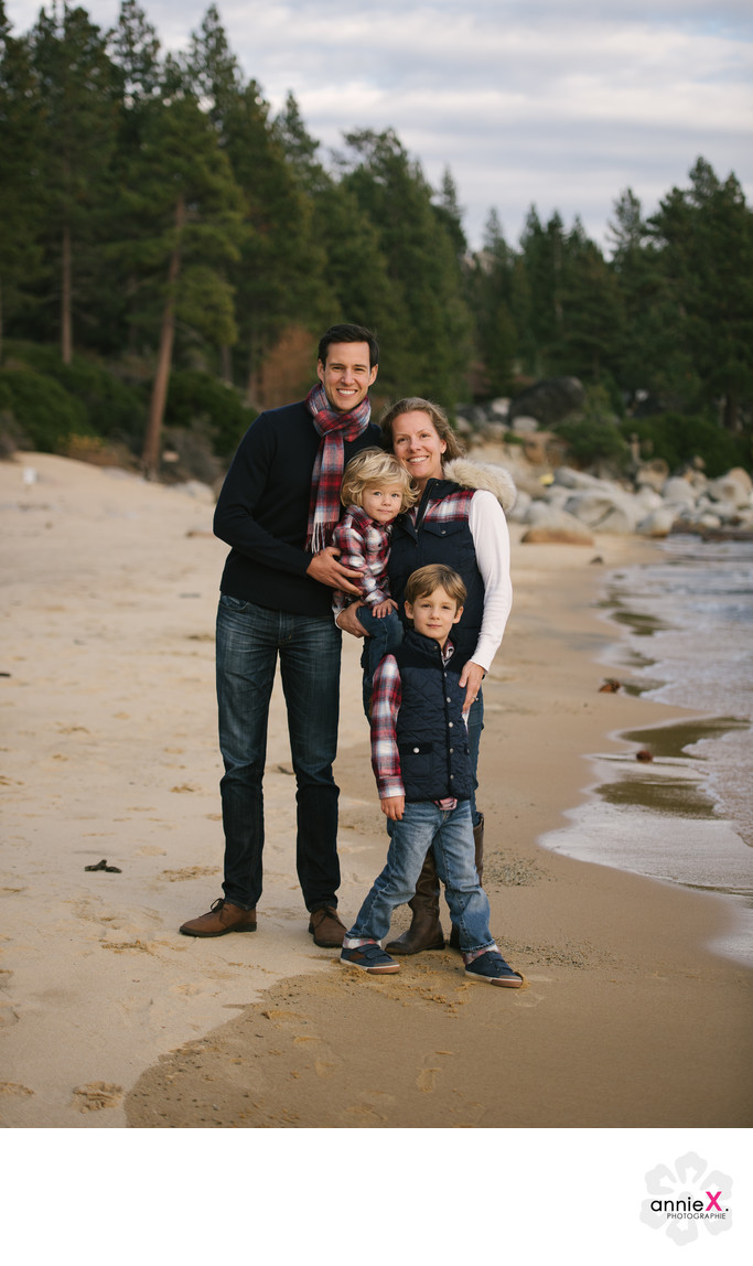 Family in plaid on beach in Lake Tahoe