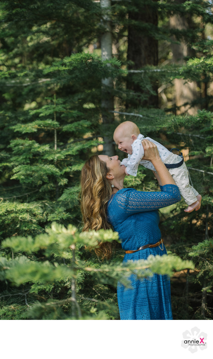 mother and baby in pine trees in Lake Tahoe