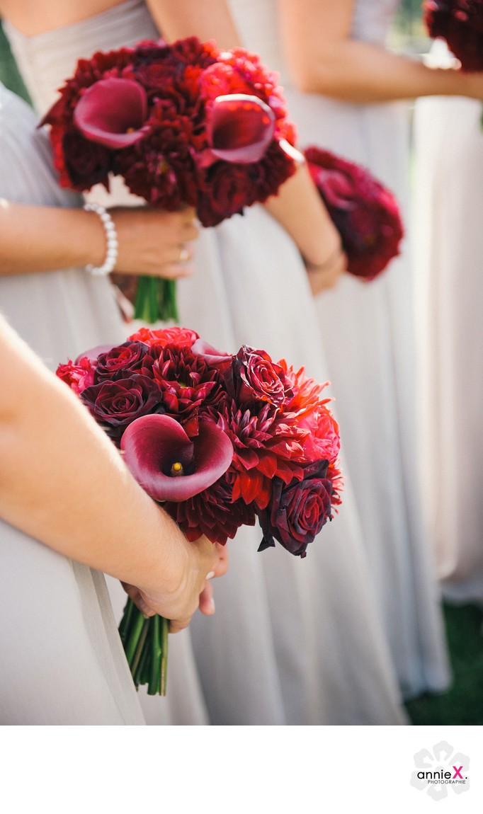 Red bridesmaids bouquets at Martis Camp wedding