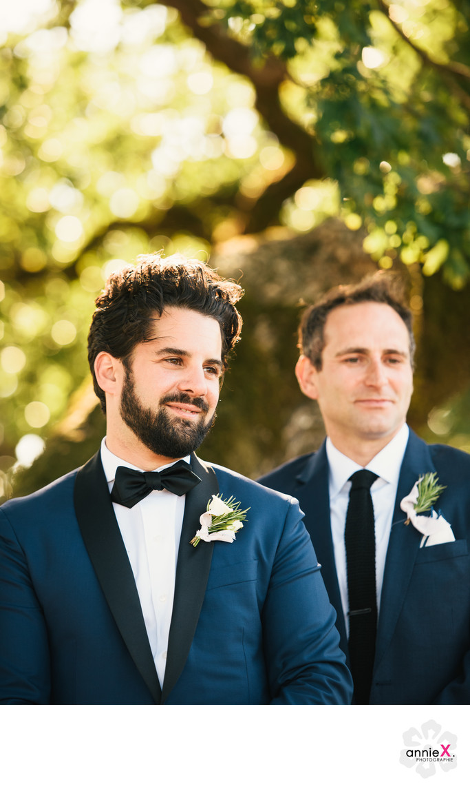 Dapper groom in navy suit during ceremony  Healdsburgh