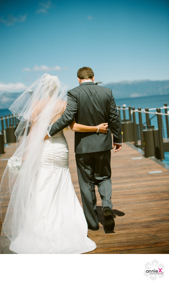 newlyweds walking on West Shore cafe pier