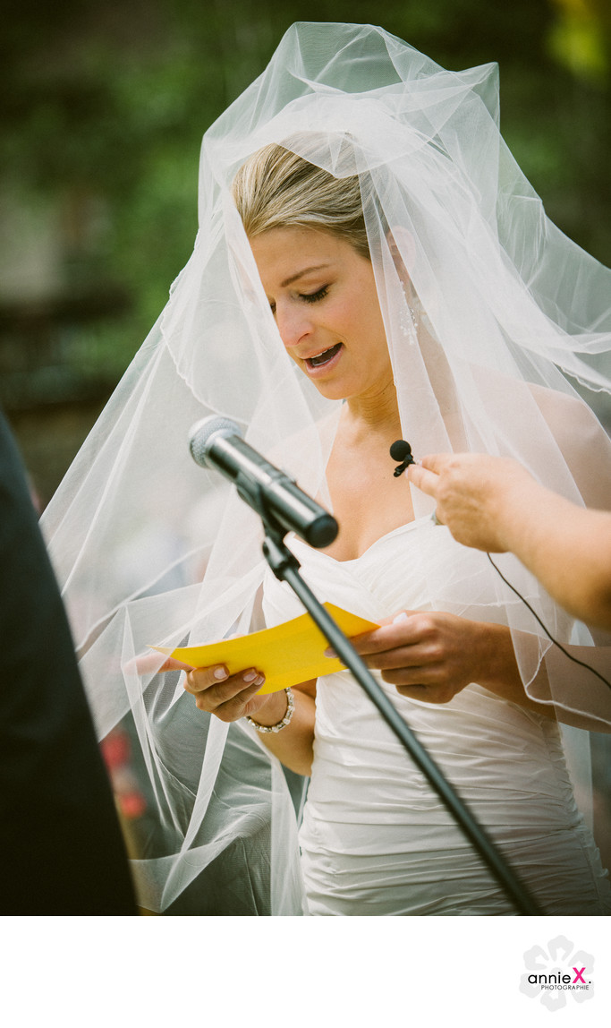 bride reading vows at West Shore cafe