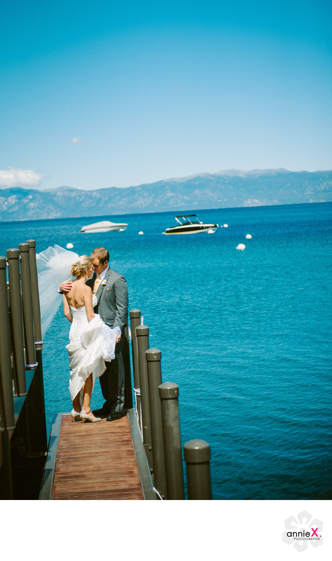 Newlyweds on West Shore cafe pier in Lake Tahoe
