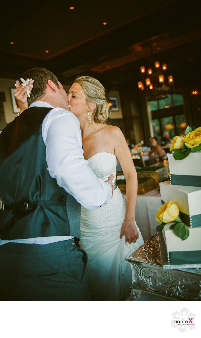 Cutting cake and kissing at West Shore cafe