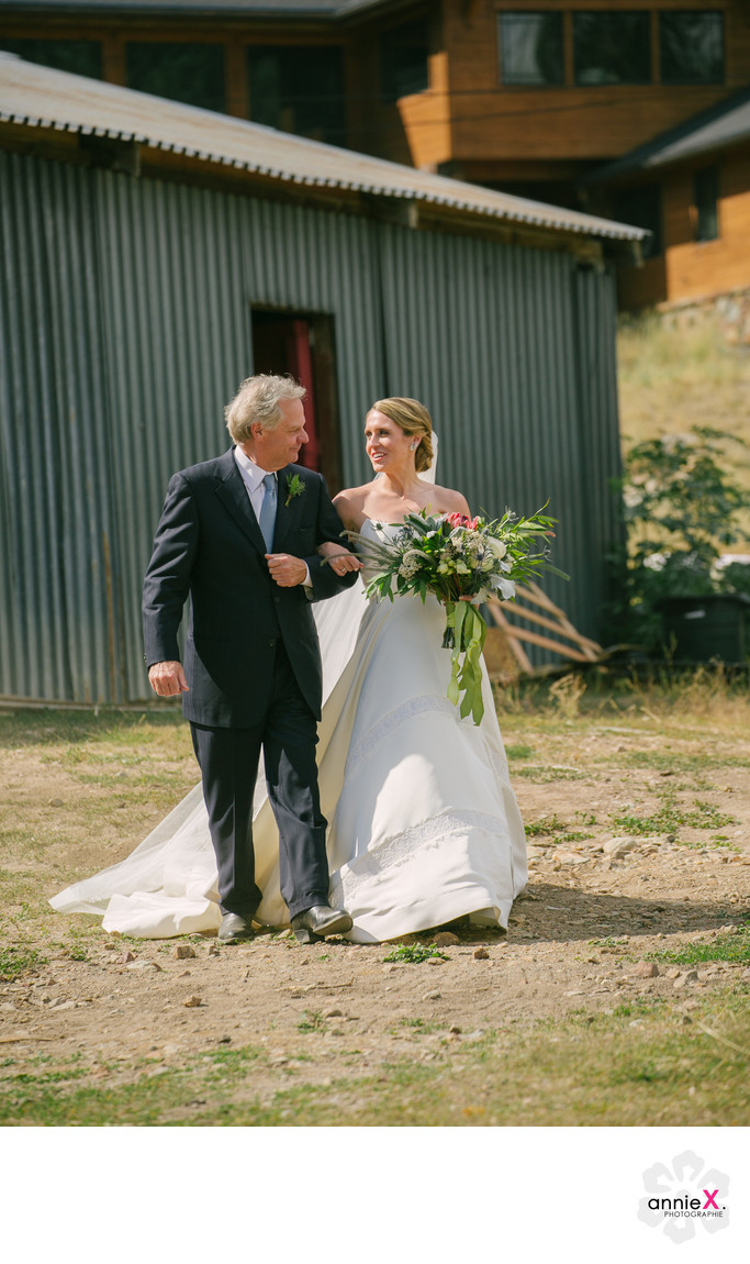 father and bride walking to ceremony at the Stables