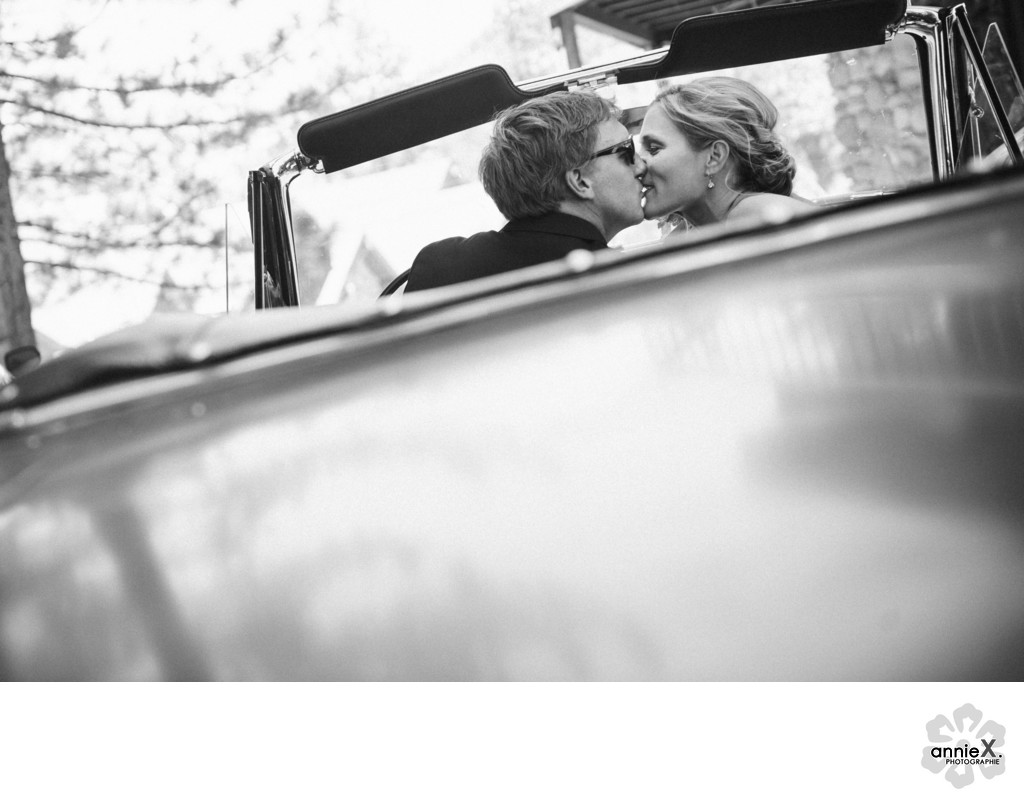 Bride and groom in Vintage convertible