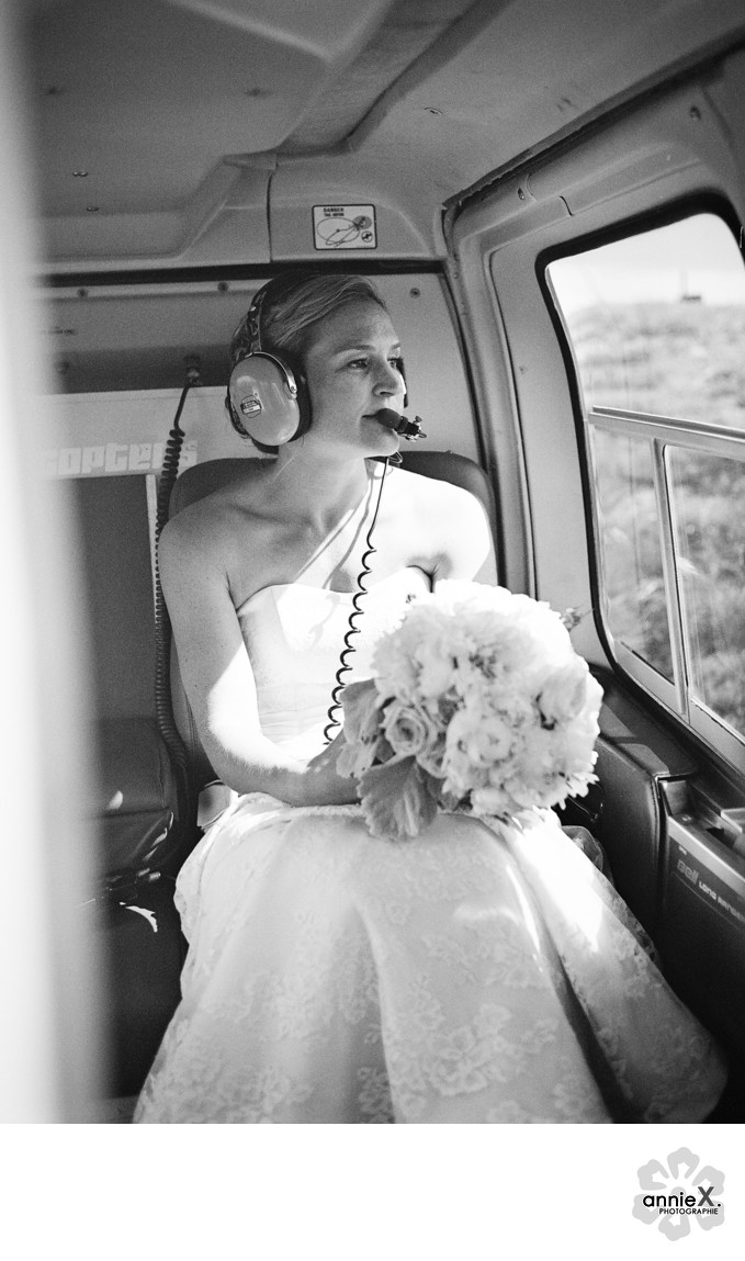bride with earphones in helicopter during flight