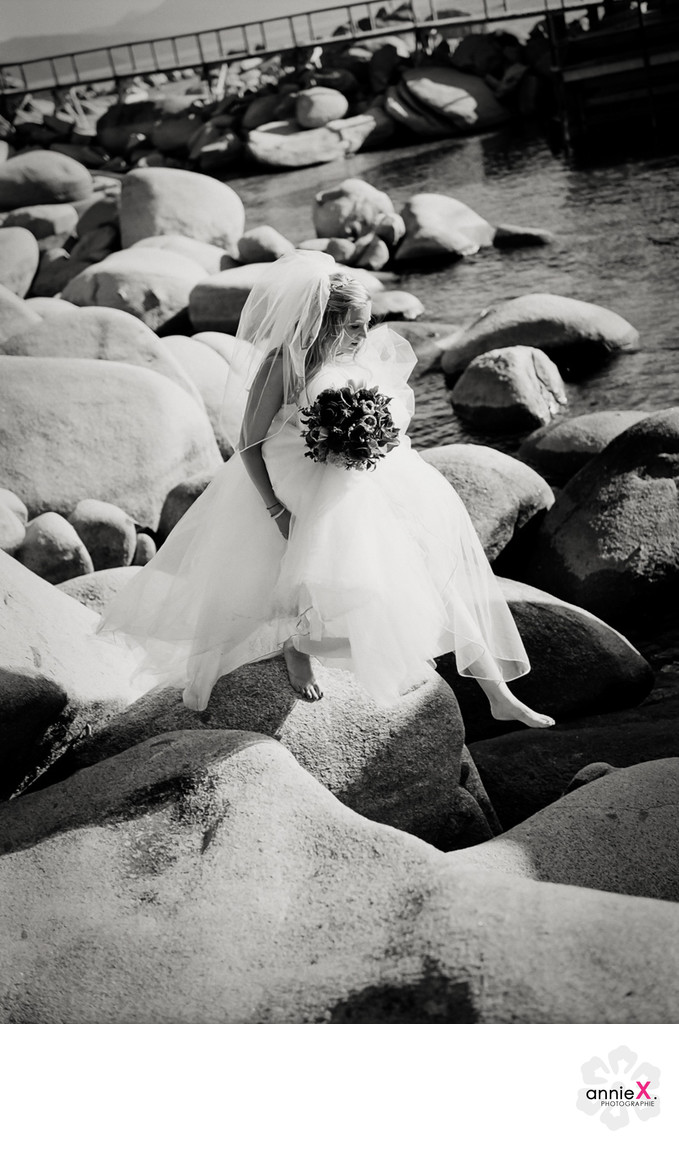 Black and white  bride  on boulders in Lake Tahoe