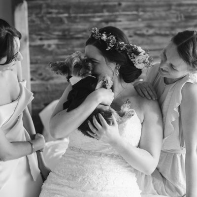 Bridesmaids bride and her dog while getting ready