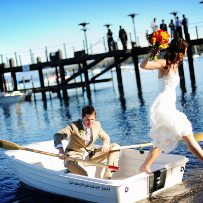 Bride and Groom in rowboat at West Shore Cafe