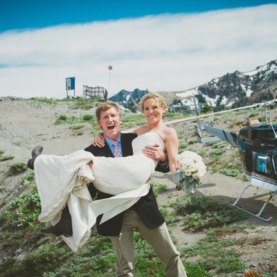 Bride and groom on top of Kt-22 with helicopter