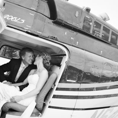 Bride and groom in helicopter getting ready for takeoff