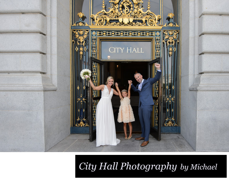 City Hall Yay with bride groom and daughter after wedding