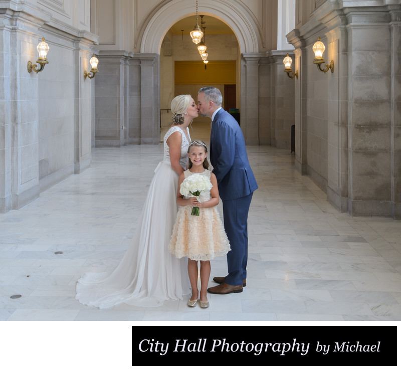 Best Kiss over daughter - San Francisco City Hall Wedding Photographer