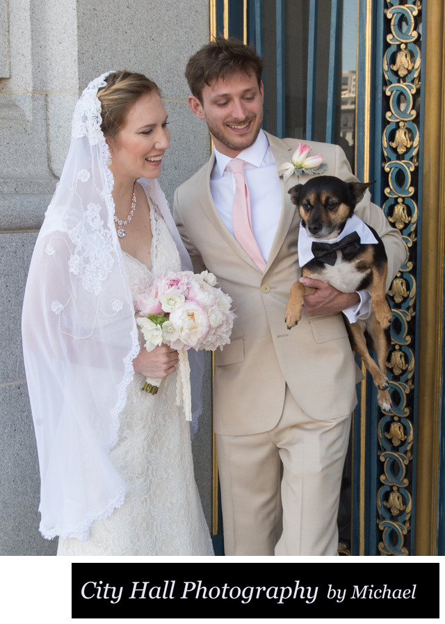 Bride and groom  with their dog wearing a tux
