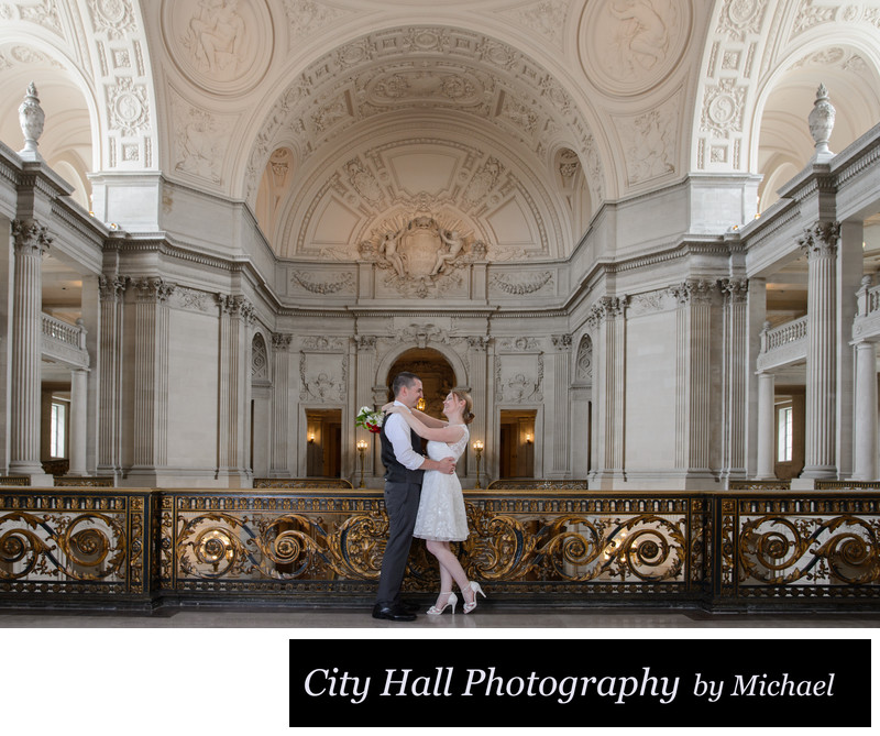 Bride and Groom posed on the Mayors Balcony City Hall