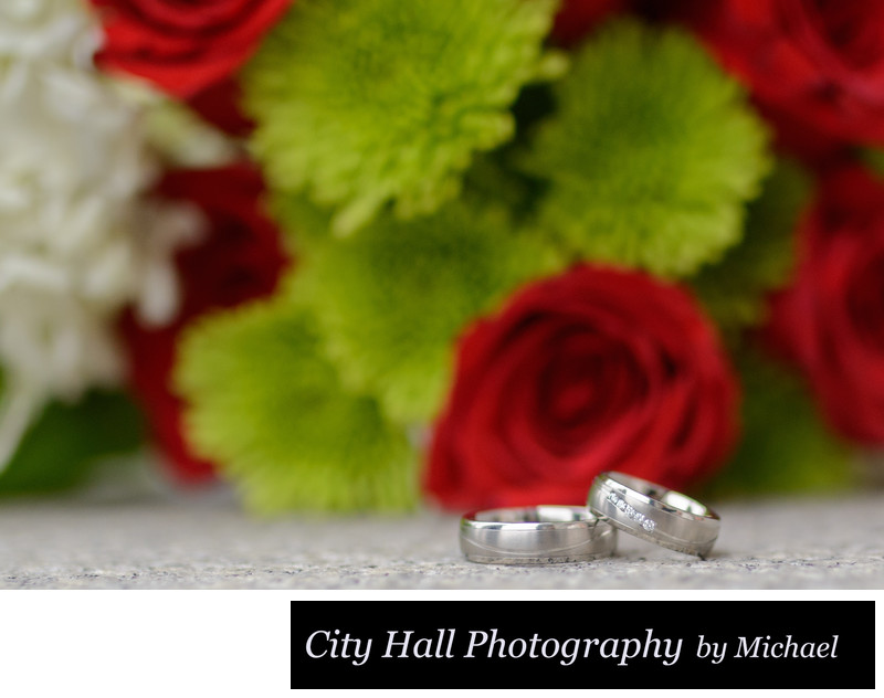 Wedding rings flower bouquet close up photo