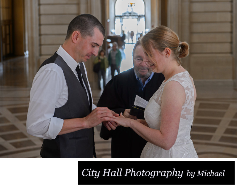 Ring exchange on the Grand Staircase wedding ceremony