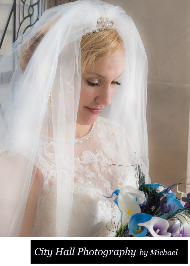 Bride Bouquet with face framed by veil in natural light