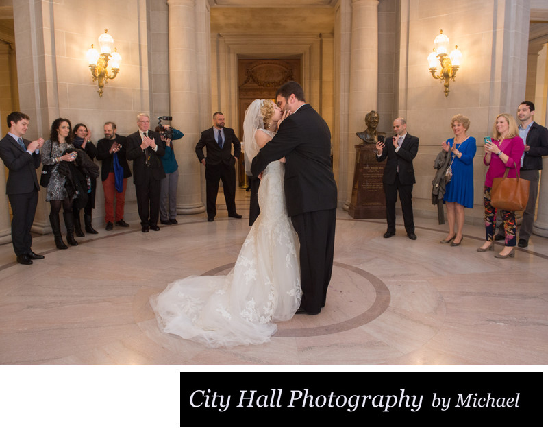 Nuptial Kiss City Hall Wedding Photographer's Image