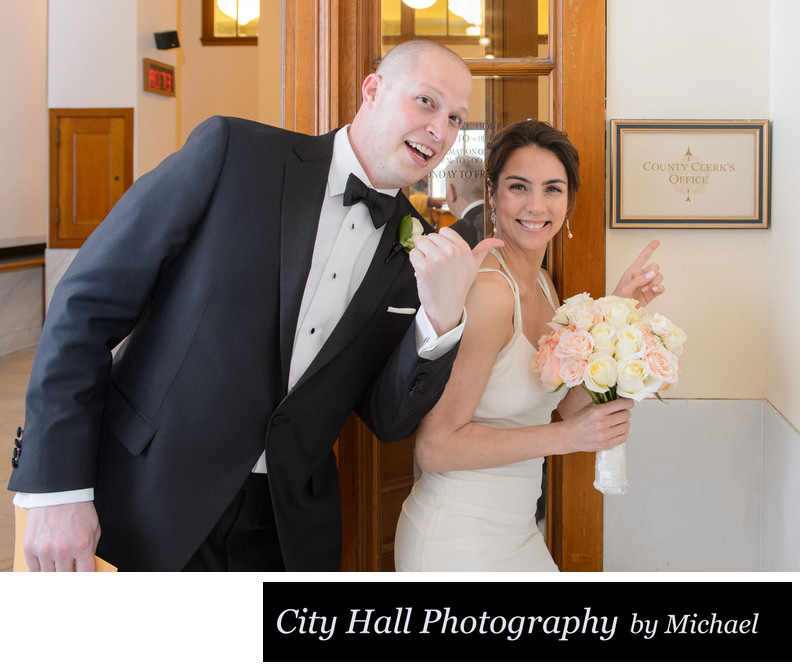 San Francisco bride and groom point County clerk sign