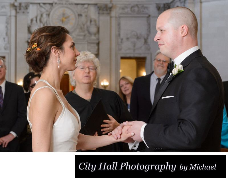 Exchanging rings City Hall ceremony with officiant in SF