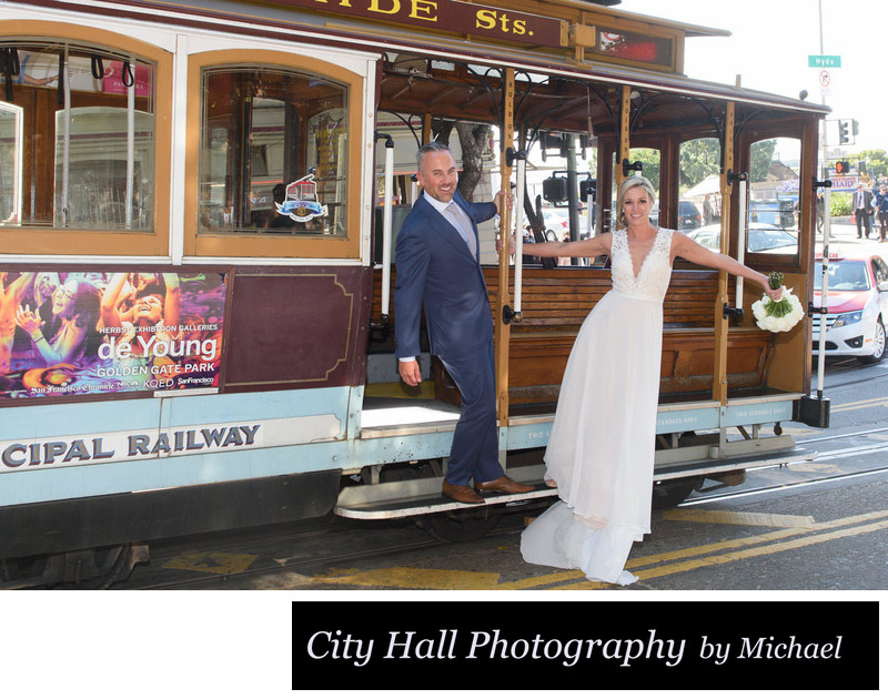Fun Newlyweds Hang off of a Cable Car for San Francisco Photography