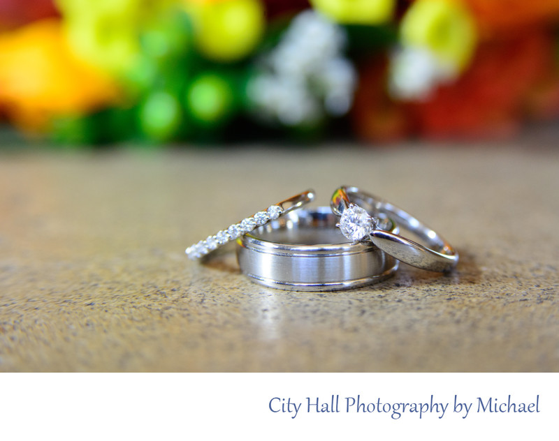 wedding rings bouquet close up photographer