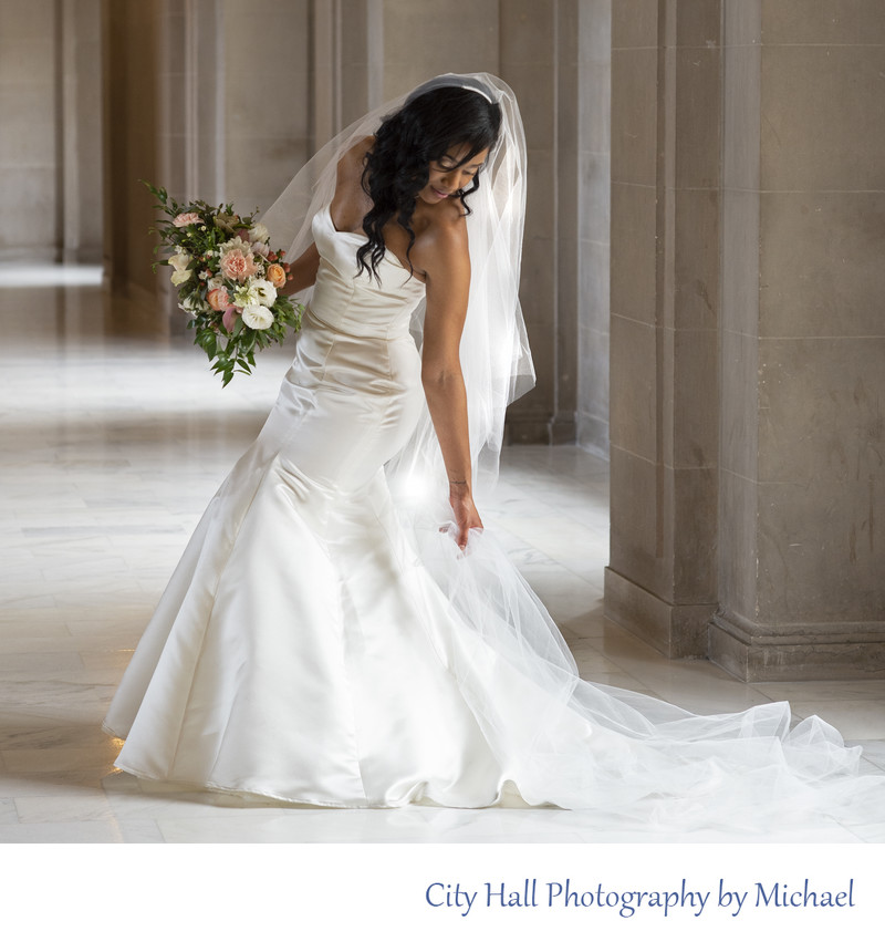 City Hall Bride Adjusting her Dress in between Wedding Photos