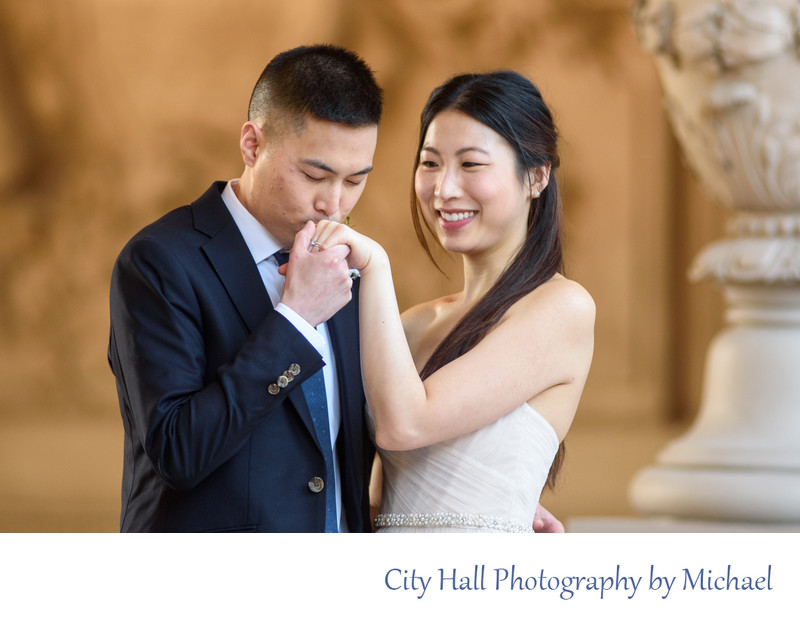 Groom kissing hand during San Francisco wedding