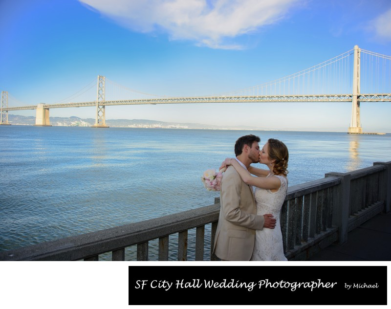 San Francisco Bay Bride Wedding Photo over the water with a kiss