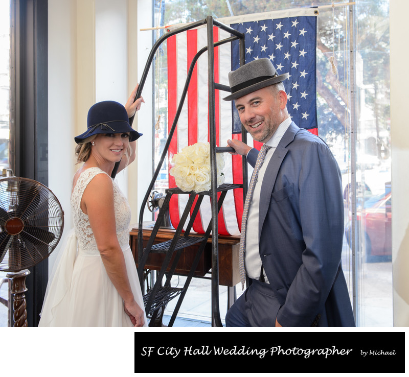 Window photo of Bride and Groom at North Beach Hat Shop