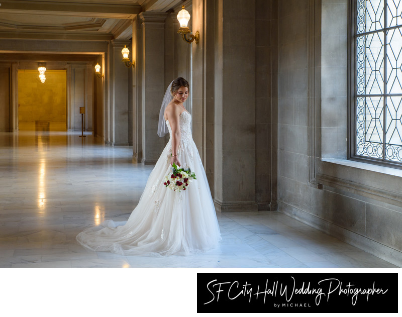 Beautiful bride by 3rd floor window at city hall