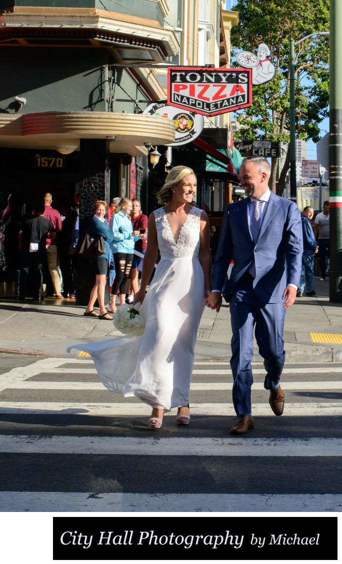 Recently Married couple walks by Tony's Pizza San Francisco