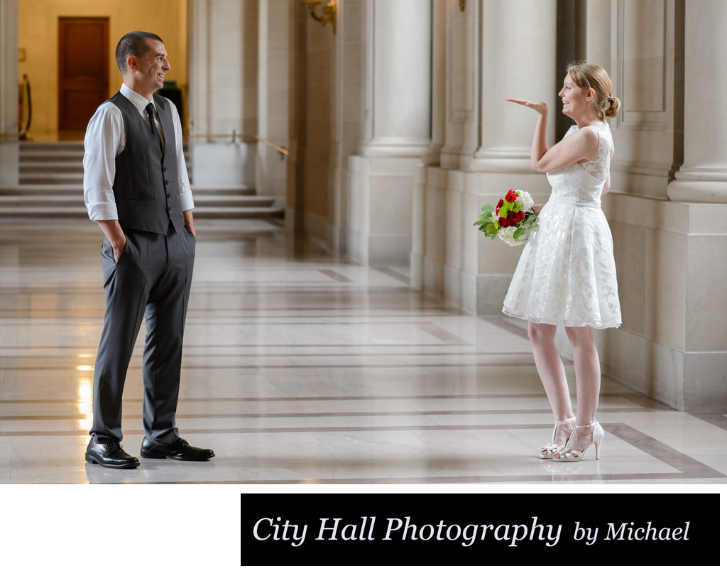 San Francisco City Hall Wedding Photographer - Bride Blowing Kiss