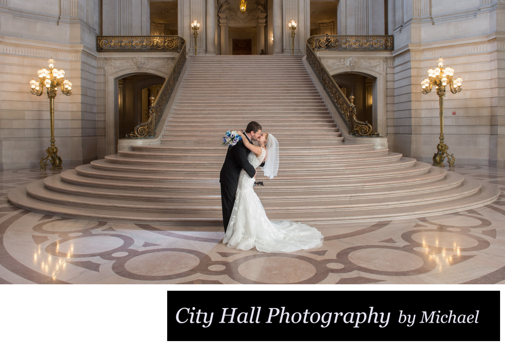 Grand staircase kiss with Professional Photographic Back Lighting