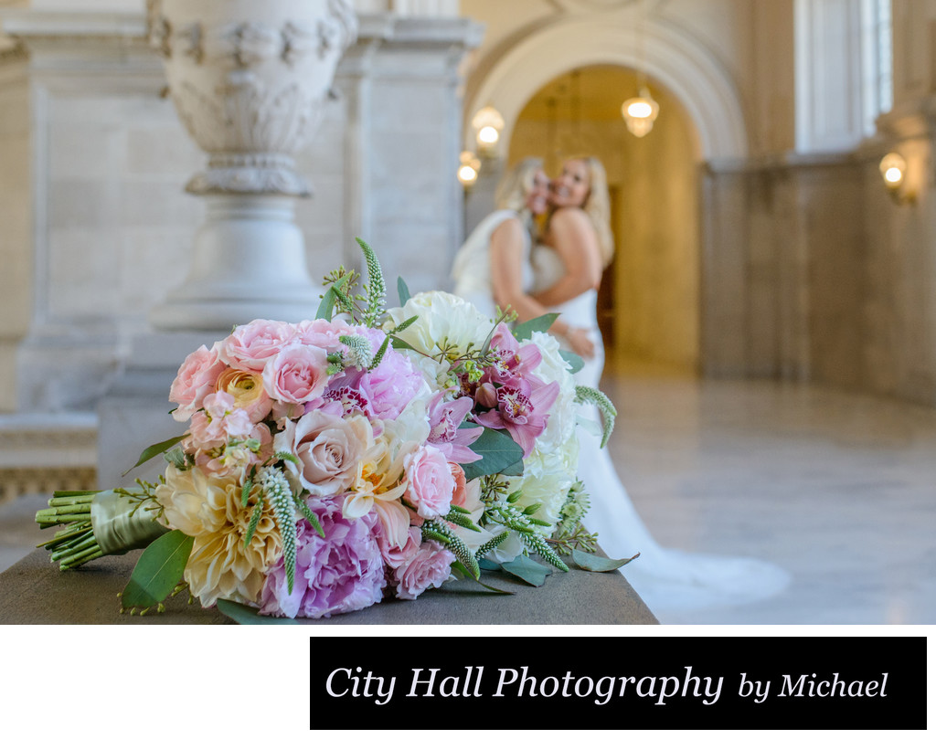 Selective focus wedding photographer with LGBT Couple