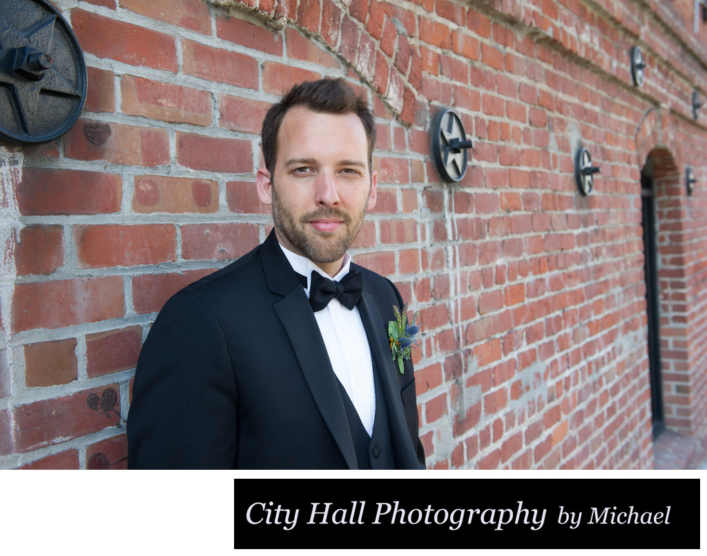 Wedding Photographer San Francisco City Hall - Groom in Bricks